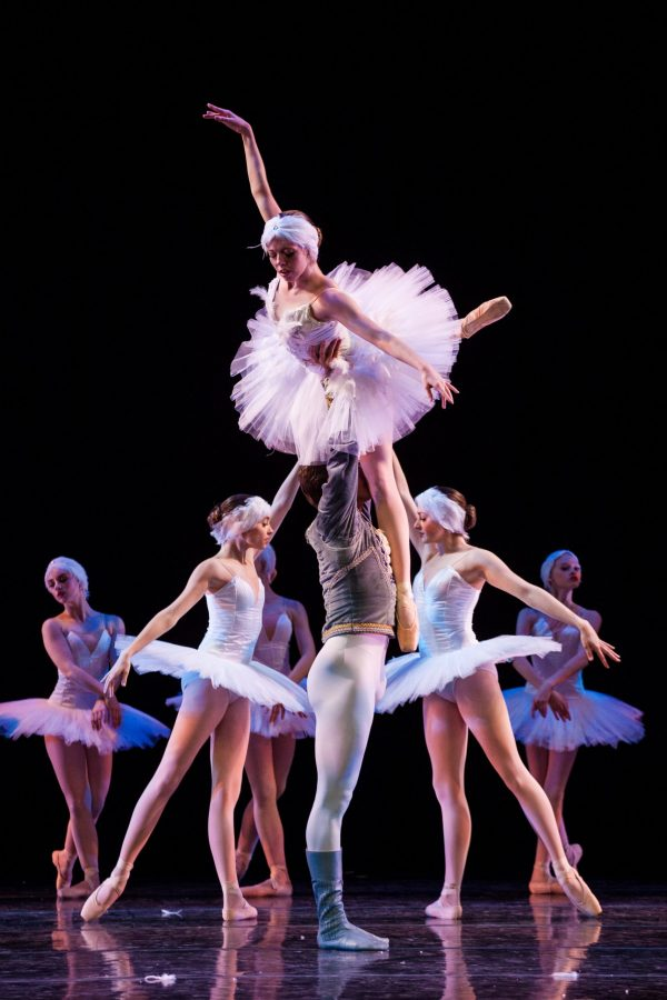 Dancers in Pre-Professional Ballet Program Performing with One Dancer in Tutu being Held Up in Air by 3 Dancers
